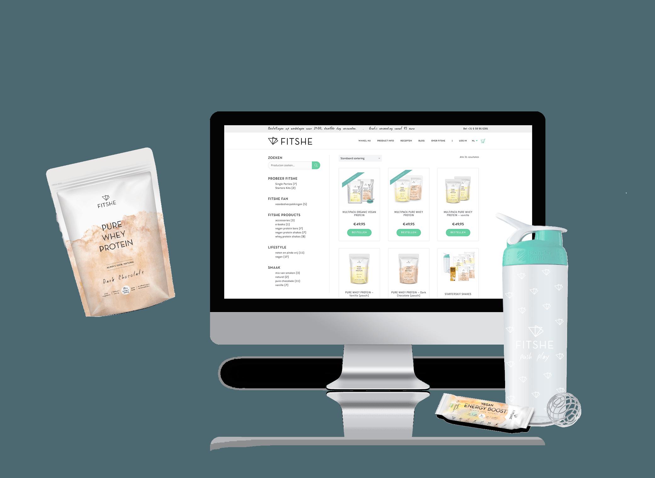 FITSHE shaker en proteïnereep naast een iMac met de online shop weergegeven
